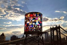 """Stain Glass Water Tower    """"the locally-sourced plexi came from all over new york city—from the floors of chinatown sign shops, to the closed dumbo studioof artist dennis oppenheim, to astoria's demolition salvage warehouse. build it green! nyc""""- tom fruin studio      Right in our (Brooklyn office) backyard!"""