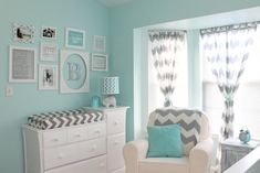 This aqua and gray chevron nursery features a beautiful gallery wall! #nursery #chevron