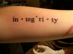 I love the idea of a phonetically spelled word as a tattoo.... although not integrity. maybe \əd-ˈven-chər\  (adventure)