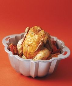 Use your Bundt pan to roast chicken thats crispy all the way around. Place carrots, onions, and potatoes in the pan and then place the chicken, cavity side down, over the center. Season as usual and place pan on a cookie sheet to catch drips. Roast at 400 degrees for 15 minutes per pound plus 15 minutes.