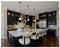 Black kitchen cabinets have a rich, timeless look for a stylish luxe kitchen.