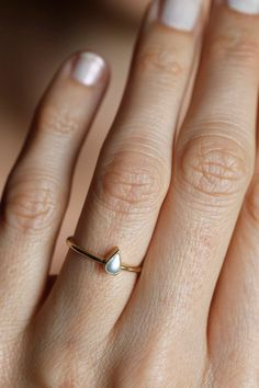 A delicate pearl teardrop makes a beautiful and unusual engagement ring.