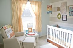 The orange chevron curtains are such a sweet pop of color in the #nursery!