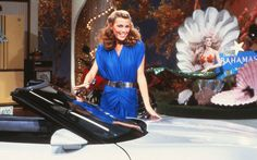 Modeling in front of a Wheel of Fortune prize - a convertible car!