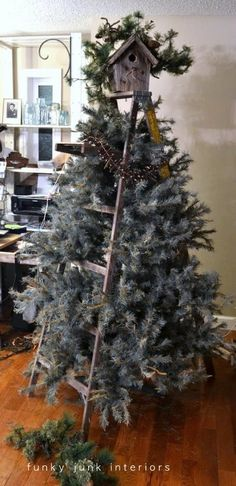 DIY Rustic Christmas tree using a step ladder - wish I would have seen this earlier.  From the marvelous Funky Junk Interiors blog....GENIUS!
