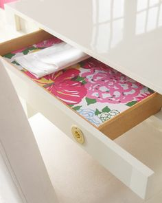 Make the insides of your drawers COLORFUL by using Lilly Pulitzer wrapping paper as a liner!
