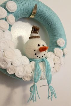 I wouldn't necessarily make a snowman wreath but I like the idea of wrapping the wreath with yarn