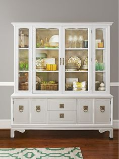 2638828593901326951 white glossy china cabinet with brass metal screening stapled to back