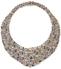 A multi-coloured sapphire and diamond bib necklace. The graduating bib collet-set throughout with variously coloured sapphires, weighing approximately 177.00 carats, and similarly set diamonds, inner diameter 12.5cm, diamonds estimated 6.30 carats. Via Phillips.