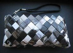 OP: Cute wristlet made from magazine pages. She includes links to instructions at the source. (I know candy wrapper purses are kind of old news, but the black & white is really fresh - and I still want to make one some day!)