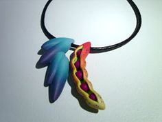 Jeffrey Lloyd Dever - Seeded Promise   Polymer clay, & braided leather