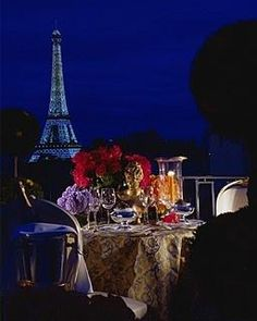 A romantic dinner with a view of the Eiffel tower. Four Seasons Hotel George V, Paris > Romantic dinner set-up on private balcony > At Four Seasons, you enjoy a unique vantage point from which to explore the sights, sounds and experiences around you.