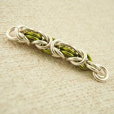 Quick Byzantine Tutorial showing non tarnish silver plate a peridot green. Byzantine Weave is a somewhat tolerant weave so you can get away with a variety of rings, but it is best when the weave is flexible but doesn't bind when flexed and the pattern hold together. We use 18 gauge 3.75mm ID rings in this tutorial.
