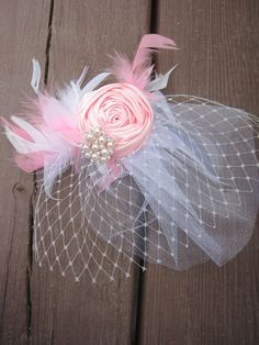 Pink and White Satin Rose with Feathers, Bling Tulle and Netting - Baby Headband or Hair Clip - Rhinestones,Newborn, Infant, Toddler, Adult. $23.00, via Etsy.