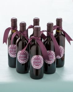 Mini wine bottle favors with custom labels designed by Minted.