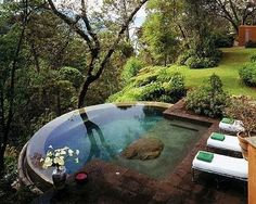 I can't believe this actually exists somewhere.  Unreal pool in the woods