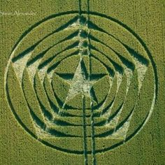 The Long Man of Wilmington, Long Man, East Sussex.The five-pointed star inscribed in a pentagon in the crop circle motif points back to the ancient grid that long barrows and stone circles laid out.  The star and pentagon are geometric signatures of the stellated icosahedron and dodecahedron, comprising five interpenetrated tetrahedras.