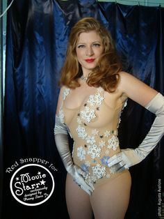 Winter Wonderland BodySuit: not meant to be stripped out of, this body suit features stiffen felt snow flakes, rhinestones and snow flake paillettes carefully placed. model:  Red Snapper