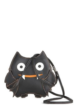 Baby Got Bat Bag (ModCloth, $29.99)    DETAILS:  Vinyl.  Bag measures 7 inches in height, 7.5 inches in length, 1.25 inches in width. Removable strap is adjustable and measures 53 inches in length.  Top zipper closure. One exterior pocket. Two interior pockets.  Imported