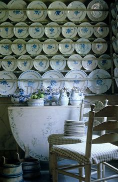 Rows of blue and white plates are displayed on wall-to-wall plate racks in the china pantry ~ Skogaholm Manor in Sweden