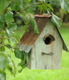 birdhouse with a rusty roof