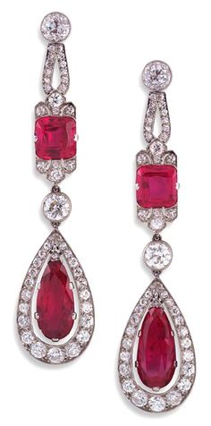 Pair of Art Deco ruby and diamond ear-pendants, each pear-shaped ruby drop in diamond frame suspended from a cushion-shaped ruby and diamond mount.