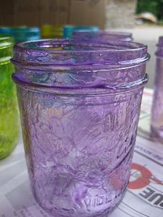 tint jars----Pour about a 1/4 cup of  Outdoor Mod Podge onto a plastic plate and add 5 - 7 drops (depending on how light or dark you want your color) of food coloring.  I used McCormick's Neon Food Coloring (except the yellow - which is from a plain old box of food coloring).  BTW - this was MORE than enough of the mixture to cover three glass jars.