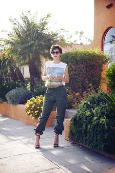 Wearing Topman tank, American Apparel bra, vintage cargo pants from American Rag, Karla Deras for Roman Luxe rings, Givenchy sandals, and vintage Emmanuelle Khahn sunglasses.