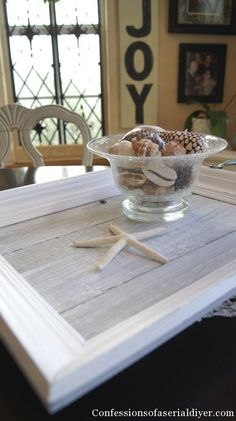 Old fence pickets, a frame, and some drawer pulls are all you need to make this lovely upcycled fence picket trayby Confessions of a Serial DIY'er.