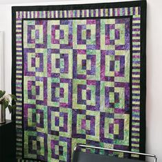 Quilt designed and made by Nancy Mahoney. Machine quilted by Kelly Wise.You'll enjoy making this eye-catching quilt. Designer Nancy Mahoney used batiks in a vivid purple and green color combination, but any pairing would make a striking quilt.