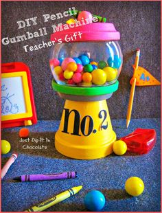 DIY Pencil Gumball Machine Teacher's Gift, turn your favorite pencil into a Gumball work of art. Resembling a No.2 pencil, this gumball machine will bring a smile to your child's teacher for sure! via @Liz Mester Mester Mester Mester Young McGow
