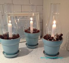 Glass Chimney Candle Holders using flower pots and hurricane / lantern tops.  Would make great little patio decorations.  (can use a citronella candle)