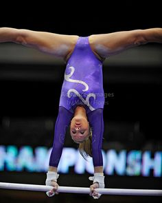 Gymnast on uneven bars during meet, WAG, Womens Gymnastics Day 2 by Advanced Images of Texas #KyFun texa