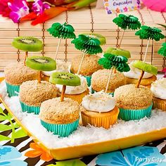 Supercute kiwi palm tree cupcakes & more sweet luau party dessert table ideas.