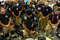 praying firemen