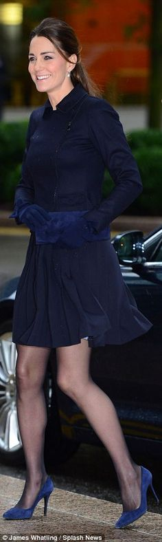 Her pleated skirt was by Orla Kiely skirt and her matching navy jacket was by MaxMara