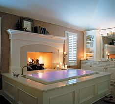 Infinity bath tub with fireplace. Wow!
