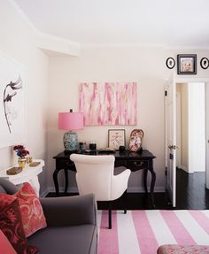 pink and white rug + pink abstract art + pretty pink pillows + pink lampshade + cute accessories =  domestic bliss I love the black desk
