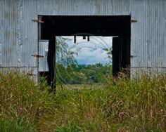 As we were pulling away from a field photo shoot, I saw this natural frame the building made for the field behind it.  I love the way it turned out.