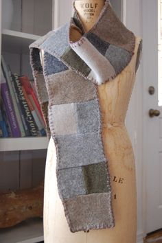 Then take the leftover scraps and make this scarf.  The pieces were sewn together by hand, then pressed with an iron.  When pressing felted wool, cover with a towel so as not to scorch.  Lastly, add a blanket stitch going all the way around.