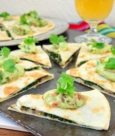Yummy Mushroom-Spinach Quesadilla topped with Guacamole.