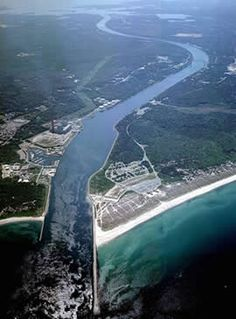 Aerial View of the Cape Cod Canal ~ The Canal provides a unique, close-up view of ocean going ships and tugs underway as they utilize the canal route between Cape Cod Bay and Buzzards Bay.