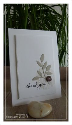"handmade card ... clean and  simple design ... neutral colors ... raised panel on top of larger base panel ... montage ... stamped woodgrain circle ... ""thank you"" in script stamped over ... die cut leaves ... sweet button ... simply elegant!"