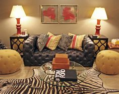 Tufted #sofa with #red accented #decor and genuine #zebra #hide #rug vignette at #Chicago #Mecox #TomFord #interiordesign #MecoxGardens #furniture #shopping #home #decor #design #room #designidea #vintage #antiques #garden