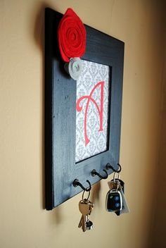 Rosette picture frame key holder. Can use scrapbook paper & chipboard for the monogram.