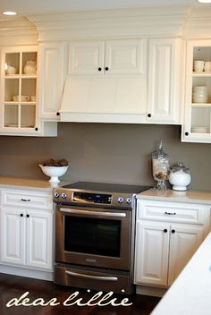 Simple beautiful hood vent and cabinets. I like this a lot