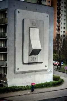During Poland's Katowice Street Art Festival that took place between 20-29 April 2012, a handful of street artists joined forces to recreate the city's face. Valencia-based street artist Escif chose to compose a huge On/Off Switch Mural on the side of an apartment building.