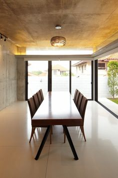 Luxurious Modern Residence for Perfect Living Space: Smooth Rectangular Wooden Dining Room Table Manufactured With A Legs Coupled By Brown Q...