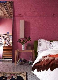 Pink Exposed Brick Wall in Eclectic Bedroom