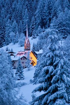 Mountain Village, The Dolomites, Italy. I love how the church's light pops out of the blue winter background. Italy is a beautiful place. #Italy